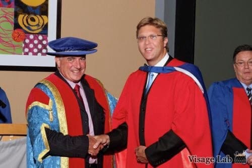 Alan receiving his PhD from Dr. Roy Marcus